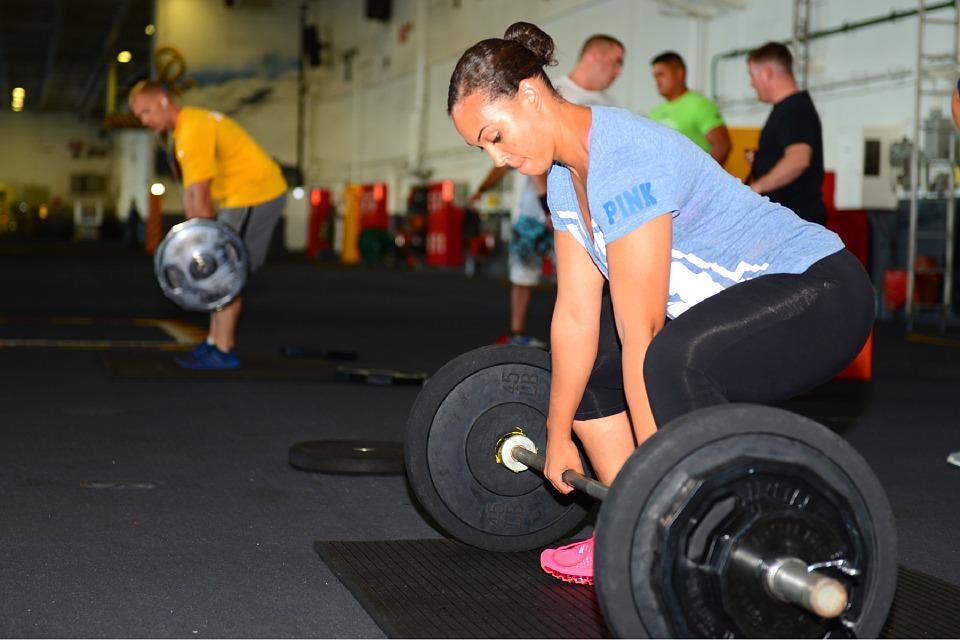 Alex Szabo Osteopathy - woman weight lifting